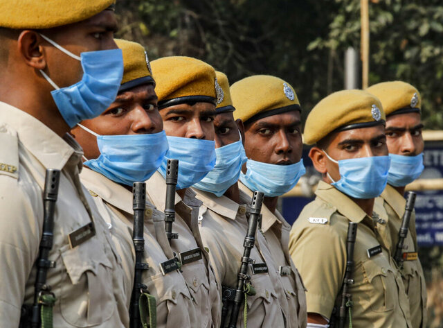 Indian policemen wearing face mask to prevent the spread of the coronavirus march during rehearsals of Republic Day parade in Kolkata, India, Friday, Jan. 22, 2021. (AP Photo/Bikas Das)