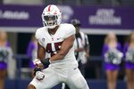 Stanford linebacker Ricky Miezan (45) celebrates a defensive stop against Kansas State in the second half of an NCAA college football game in Arlington, Texas, Saturday, Sept. 4, 2021. (AP Photo/Tony Gutierrez)