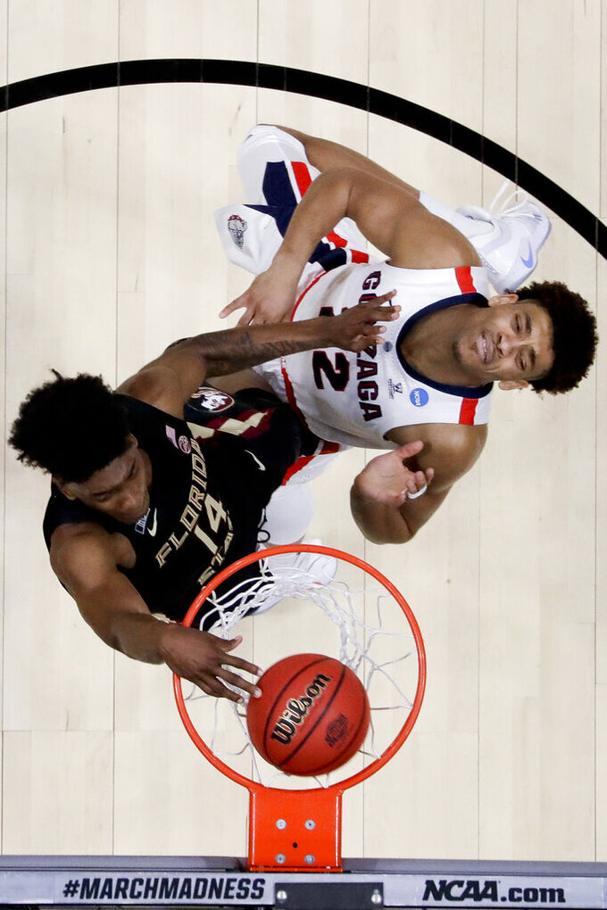 Florida State guard Terance Mann, left, dunks past Gonzaga forward Jeremy Jones during the second half an NCAA men's college basketball tournament West Region semifinal Thursday, March 28, 2019, in Anaheim, Calif. (AP Photo/Marcio Jose Sanchez)