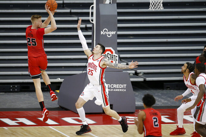 Illinois State's Alex Kotov, left, passes the ball over Ohio State's Kyle Young during the first half of an NCAA college basketball game Wednesday, Nov. 25, 2020, in Columbus, Ohio. (AP Photo/Jay LaPrete)