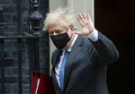 Britain's Prime Minister Boris Johnson leaves 10 Downing Street to attend the weekly Prime Minister's Questions session in parliament in London, Wednesday, April 28, 2021. (AP Photo/Frank Augstein)