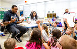 In this Sept. 23, 2019 photo, , Baltimore Ravens Cornerback Brandon Carr speaks to students during the Ravens Huddle for 100 Caw to Action event in Baltimore. (NFL via AP)