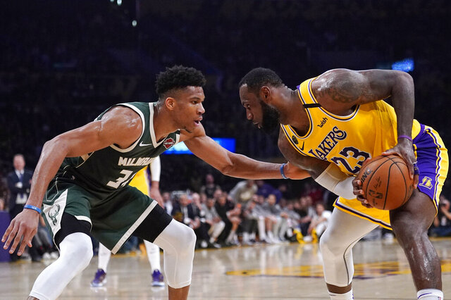 Los Angeles Lakers forward LeBron James, tries to get past Milwaukee Bucks forward Giannis Antetokounmpo during the second half of an NBA basketball game Friday, March 6, 2020, in Los Angeles. (AP Photo/Mark J. Terrill)