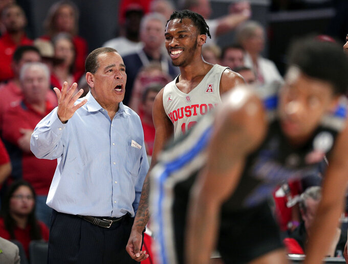 Houston head coach Kelvin Sampson, left, and guard Dejon Jarreau, right, talk during a free throw against Memphis during the second half of an NCAA college basketball game Sunday, Jan. 6, 2019, in Houston. (AP Photo/Michael Wyke)