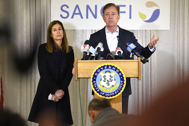 Connecticut Gov. Ned Lamont, right, speaks to the media as Lt. Gov. Susan Bysiewicz, left, looks on, during a visit to Protein Sciences, Thursday, March 12, 2020, in Meriden, Conn. The biotech company is currently researching a vaccine for COVID-19. For most people, the new coronavirus causes only mild or moderate symptoms, such as fever and cough. For some, especially older adults and people with existing health problems, it can cause more severe illness, including pneumonia. The vast majority of people recover from the new virus. (AP Photo/Jessica Hill)