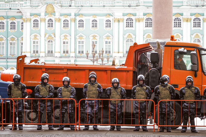Russian Rosguardia (National Guard) soldiers stand blocking enter to the Palace Square a day before Sunday's protest in St. Petersburg, Russia, Saturday, Jan. 30, 2021. As part of a multipronged effort by the authorities to discourage Russians from attending Sunday's demonstrations, the Prosecutor General's office ordered the state communications watchdog, Roskomnadzor, to block the calls for joining the protests on the internet. The Prosecutor General's office and the Interior Ministry also issued stern warnings to the public not to join the protests, saying participants could face criminal charges of taking part in mass riots if the rallies turn violent. (AP Photo/Dmitri Lovetsky)