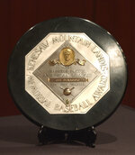 FILE - In this Jan. 22, 2006, file photo,a Joe DiMaggio 1947 MVP Award plaque is displayed at a news conference in New York. The plaque features the name and image of Kenesaw Mountain Landis. A group of House Democrats called Tuesday, Aug. 4, 2020, for the name of former baseball commissioner Landis to be pulled off future Most Valuable Player plaques. (AP Photo/Jennifer Szymaszek, File)