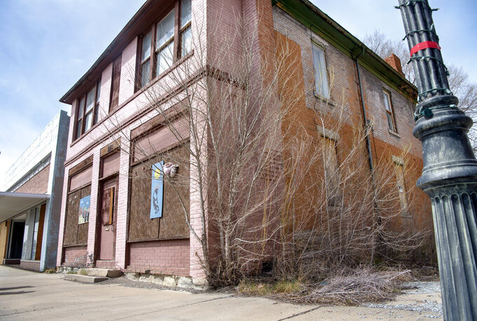 This Tuesday, April 27, 2021 photo shows downtown Raton, N.M.   Vacant buildings — some dilapidated and others that look recently abandoned — have become an unavoidable reality in Raton, a constant reminder to residents of their town's current plight. (Eddie Moore /The Albuquerque Journal via AP)