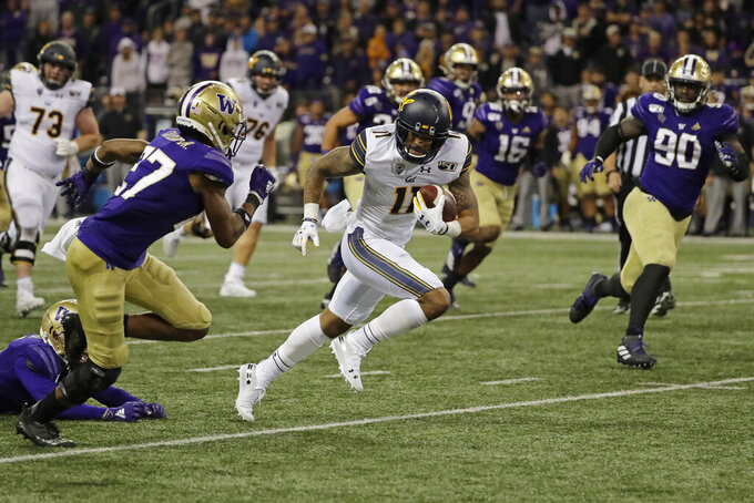California wide receiver Kekoa Crawford (11) runs the ball against Washington during the second half of an NCAA college football game in the early morning hours of Sunday, Sept. 8, 2019, in Seattle. California won 20-19. (AP Photo/Ted S. Warren)