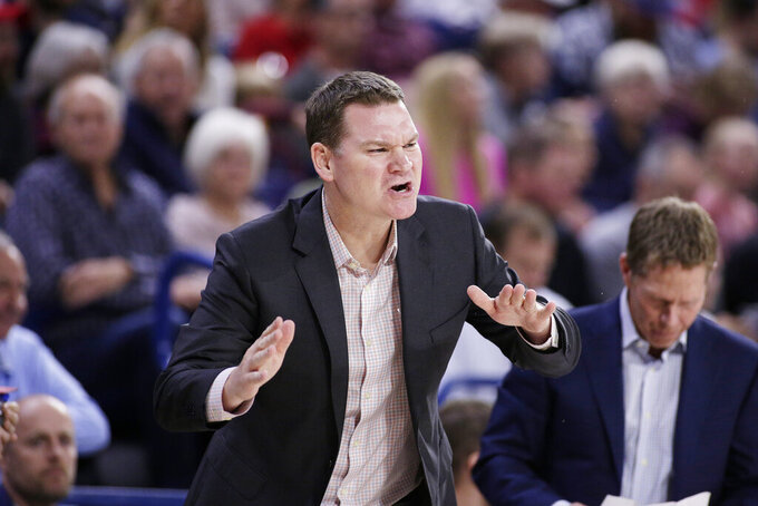 FILE - Gonzaga assistant coach Tommy Lloyd shouts to his players during the first half of an NCAA college basketball game against Texas-Arlington in Spokane, Wash., in this Tuesday, Nov. 19, 2019, file photo. Tommy Lloyd was in position to be Gonzaga's next basketball coach after Mark Few retired. A chance to coach at Arizona, one of the premier programs in the country, changed those plans. At right looking down is Mark Few. (AP Photo/Young Kwak, File)
