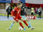 North Macedonia's Enis Bardhi, front, fights for the ball with Austria's Stefan Lainer, during the Euro 2020 group G qualifying soccer match between Austria and North Macedonia at Ernst-Happel stadium in Vienna, Austria, Saturday, Nov. 16, 2019. (AP Photo/Ronald Zak)