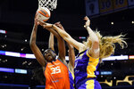 Connecticut Sun forward Jonquel Jones (35) goes up for a rebound with Los Angeles Sparks forward Nneka Ogwumike, center, and forward Lauren Cox, right, during the first half of WNBA basketball game Thursday, Sept. 9, 2021, in Los Angeles. (AP Photo/Ashley Landis)