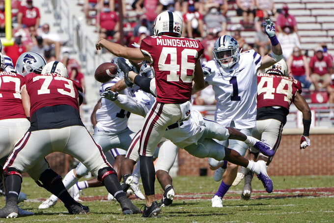Kansas State defensive back AJ Parker (12) dives to block a punt by Oklahoma punter Reeves Mundschau (46) in the second half of an NCAA college football game Saturday, Sept. 26, 2020, in Norman, Okla. (AP Photo/Sue Ogrocki).