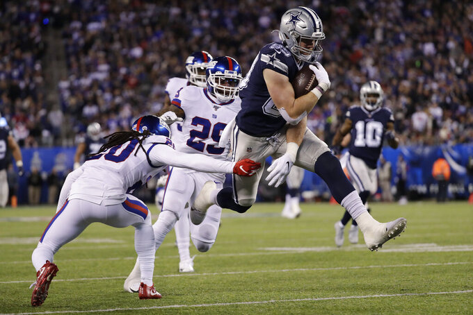 FILE - In this Nov. 4, 2019, file photo, Dallas Cowboys tight end Blake Jarwin (89) avoids a tackle by New York Giants cornerback Janoris Jenkins (20) on his way to a touchdown during the second quarter of an NFL football game in East Rutherford, N.J. A person with direct knowledge of the deal says the Dallas Cowboys and tight end Blake Jarwin have agreed on a $24 million, three-year contract. The person spoke to The Associated Press on condition of anonymity because deals can't become official until the league year begins. That's supposed to be Wednesday, March 18, 2020.(AP Photo/Adam Hunger, File)