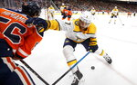 Nashville Predators' Yannick Weber (7) and Edmonton Oilers' Kailer Yamamoto (56) battle for the puck during second period NHL hockey action in Edmonton, Alberta, Tuesday, Jan. 14, 2019. (Jason Franson/The Canadian Press via AP)