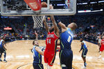 New Orleans Pelicans forward Brandon Ingram (14) goes to the basket against Dallas Mavericks forward Kristaps Porzingis (6) in the first half of an NBA basketball game in New Orleans, Tuesday, Dec. 3, 2019. (AP Photo/Gerald Herbert)