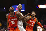 Clemson forward Aamir Simms, (25) Virginia forward Mamadi Diakite (25) and Clemson guard Clyde Trapp (0) wait for a rebound during an NCAA college basketball game Wednesday, Feb. 5, 2020, in Charlottesville, Va. (Erin Edgerton/The Daily Progress via AP)