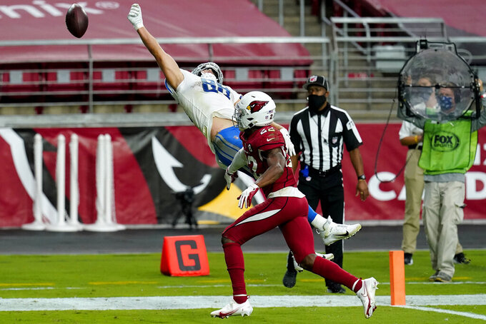 Detroit Lions tight end T.J. Hockenson can't make the catch as Arizona Cardinals safety Deionte Thompson (22) defends during the second half of an NFL football game, Sunday, Sept. 27, 2020, in Glendale, Ariz. (AP Photo/Ross D. Franklin)