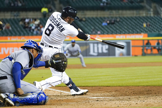 Detroit Tigers' Robbie Grossman (8) hits a three-run triple against the Kansas City Royals in the fifth inning of a baseball game in Detroit, Tuesday, May 11, 2021. (AP Photo/Paul Sancya)