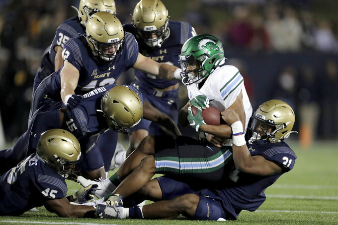 Navy's Austin Talbert-Loving, far right, gets help from teammates while bringing down Tulane's Amare Jones during a kickoff return in the second half of an NCAA college football game, Saturday, Oct. 26, 2019, in Annapolis. Navy won 41-38. (AP Photo/Julio Cortez)