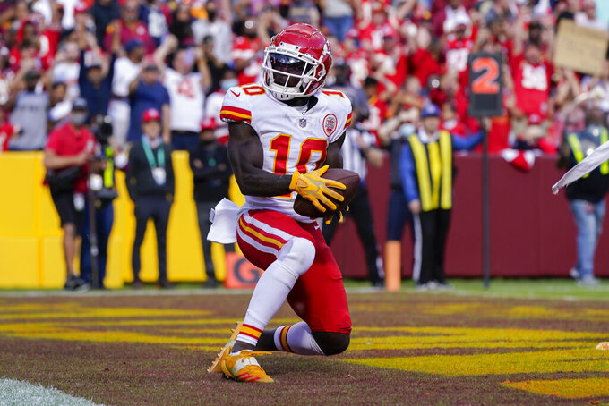Kansas City Chiefs wide receiver Tyreek Hill (10) scores a touchdown against the Washington Football Team during the second half of an NFL football game, Sunday, Oct. 17, 2021, in Landover, Md. (AP Photo/Patrick Semansky)