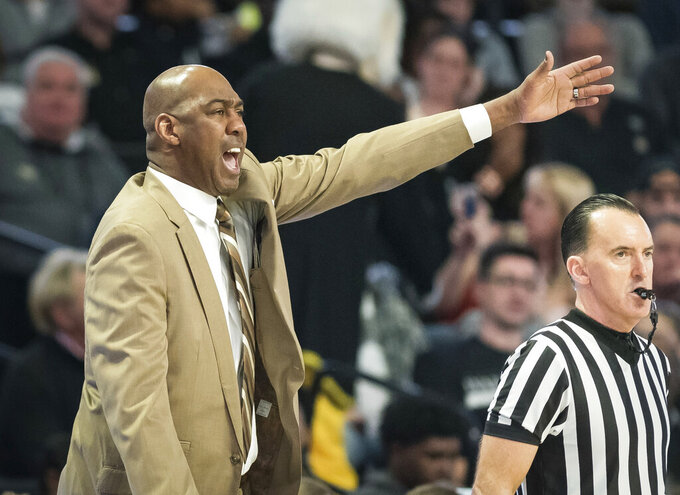 Wake Forest head coach Danny Manning directs his team in the first half against Syracuse during an NCAA college basketball game, Saturday, March 2, 2019, at Joel Coliseum in Winston-Salem, N.C. (Allison Lee Isley/The Winston-Salem Journal via AP)