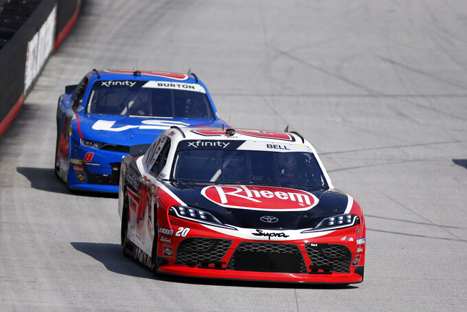 Driver Christopher Bell (20) leads Jeb Burton (8) during practice for an NASCAR Xfinity Series auto race on Thursday, Aug. 15, 2019, in Bristol, Tenn. (AP Photo/Wade Payne)