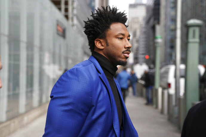 Cleveland Browns star defensive end Myles Garrett leaves an office building in New York, Wednesday, Nov. 20, 2019. Garrett is in New York for an appeals hearing to try to get the NFL to reduce an indefinite suspension that has temporarily ended Garrett's season and tarnished his career.  Garrett was banned last week for the rest of the regular season and playoffs for violently striking Pittsburgh quarterback Mason Rudolph with a helmet. (AP Photo/Seth Wenig)
