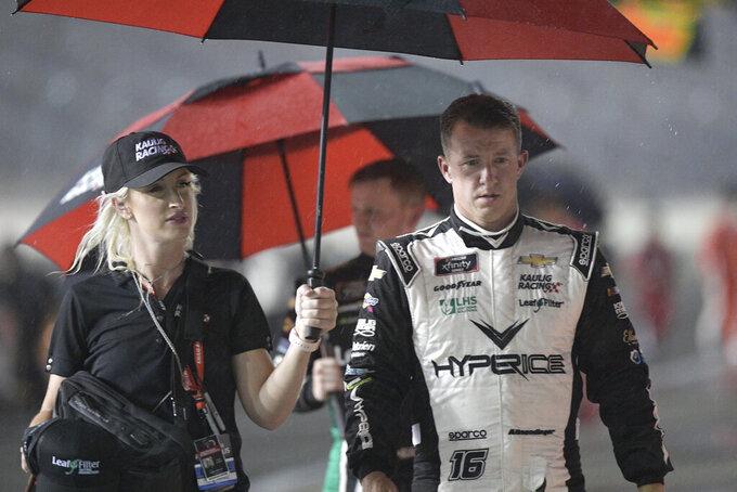 AJ Allmendinger leaves pit road during a rain delay in the NASCAR Xfinity Series auto race at Daytona International Speedway, Friday, Aug. 27, 2021, in Daytona Beach, Fla. (AP Photo/Phelan M. Ebenhack)
