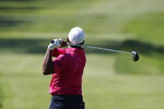 Harold Varner III drives on the sixth tee during the second round of the Rocket Mortgage Classic golf tournament, Friday, July 3, 2020, at the Detroit Golf Club in Detroit. (AP Photo/Carlos Osorio)