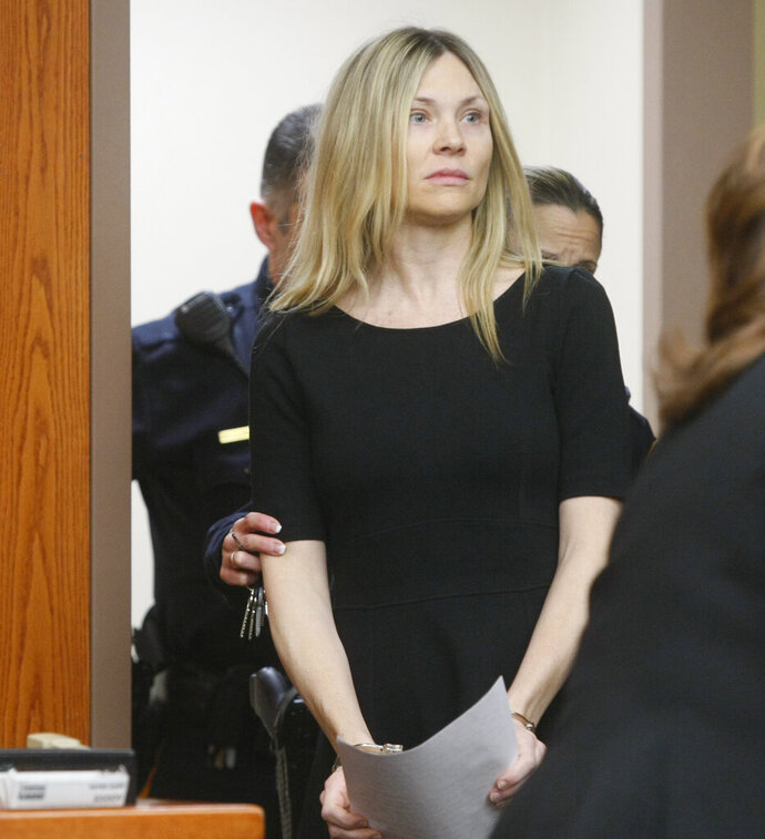 FILE - In this Feb. 14, 2013, file photo, Amy Locane enters the courtroom to be sentenced in Somerville, N.J. The former