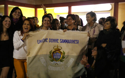 """Activists of the """"Unione Donne Sammarinesi"""" San Marino's women union camp celebrate in San Marino, Sunday, Sept. 26, 2021, the victory in a referendum to decriminalize abortion in certain circumstances. Women in San Marino seeking an abortion usually go to neighboring Italy. San Marino, one of the world's oldest republics, has a population of about 33,000 and is one of the last European states that still criminalizes abortion. (AP Photo/Antonio Calanni)"""