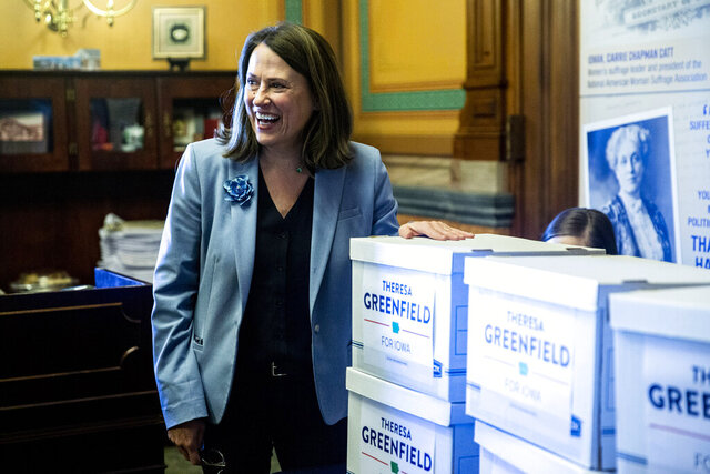 FILE - In this March 4, 2020 file photo, Theresa Greenfield, Democratic candidate for U.S. Senate, smiles at the Iowa State Capitol in Des Moines. Iowa. Greenfield will participate in a debate against her Republican opponent U.S. Sen. Joni Ernst, Thursday, Oct. 15, 2020 in Des Moines, Iowa. (Kelsey Kremer/The Des Moines Register via AP File)