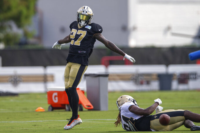 New Orleans Saints safety Malcolm Jenkins (27) denies wide receiver Lil'Jordan Humphrey (84) the ball during a one on one play during NFL football training camp at the Ochsner Sports Performance Center in Metairie, La., Thursday, Aug. 20, 2020. (David Grunfeld/The Advocate via AP, Pool)