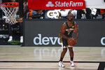 Oklahoma City Thunder guard Chris Paul (3) prepares to shoot during the fourth quarter against the Denver Nuggets during an NBA basketball game Monday, Aug. 3, 2020, in Lake Buena Vista, Fla. (Kim Klement/Pool Photo via AP)