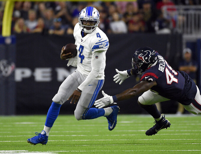 Detroit Lions quarterback Josh Johnson (4) avoids Houston Texans linebacker Davin Bellamy during the first half of an NFL preseason football game Saturday, Aug. 17, 2019, in Houston. (AP Photo/Eric Christian Smith)