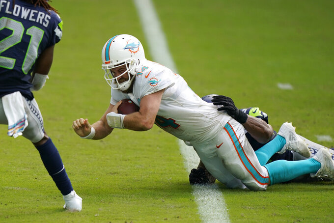Miami Dolphins quarterback Ryan Fitzpatrick (14) scores a touchdown, during the second half of an NFL football game against the Seattle Seahawks, Sunday, Oct. 4, 2020 in Miami Gardens, Fla. (AP Photo/Wilfredo Lee)
