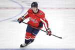 FILE - In this Sept. 16, 2019, file photo, Washington Capitals forward Connor McMichael (24) skates during warm ups before the start of an NHL preseason hockey game against the Chicago Blackhawks in Washington. Evgeny Kunzetsov's suspension for inappropriate conduct could open the door to the youngest player in Washington Capitals training camp. Kuznetsov will miss the first three games of the regular season, so the Capitals will need to fill a gaping void in the middle of the ice behind centers Nicklas Backstrom and Lars Eller. First-round pick Connor McMichael could be a year or two away from full-time NHL duty but has the chance to earn a brief tryout with Washington. (AP Photo/Susan Walsh, File)