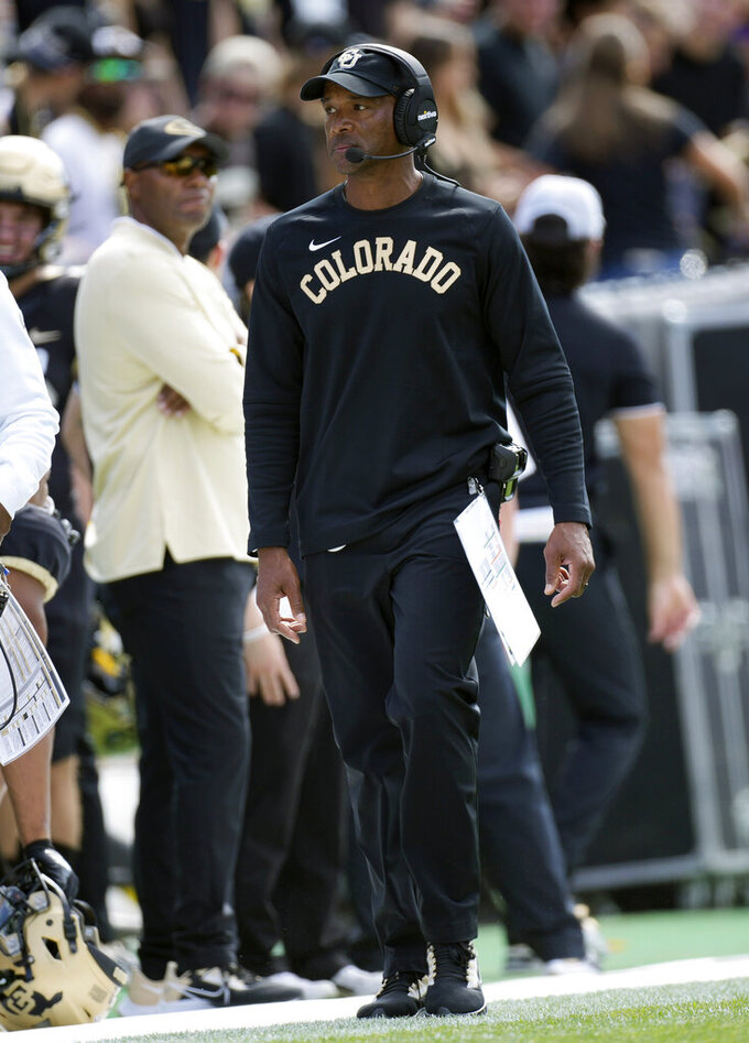 Colorado head coach Karl Dorrell walks the sideline in the first half of an NCAA college football game against Southern California Saturday, Oct. 2, 2021, in Boulder, Colo. Dorrell shoved a television photographer from a Denver CBS affiliate while leaving the field after the loss. (AP Photo/David Zalubowski)