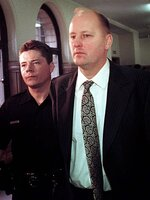 FILE - In this April 15, 1999 file photo, Tim Boczkowski is led away from a courtroom in Pittsburgh, Pa.  North Carolina's parole commission said Wednesday, Nov. 7, 2018,  it was collecting information ahead of a decision on whether to release Boczkowski. He also faces a life sentence in Pennsylvania and North Carolina state prison officials said he would be sent there if he is paroled in North Carolina after a hearing which could come as early as next month. (AP Photo/Gary Tramontina, File)
