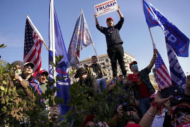 Supporters of President Donald Trump attend a pro-Trump march Saturday Nov. 14, 2020, in Washington. (AP Photo/Jacquelyn Martin)