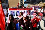 Women take part in a protest as they hold pictures of female protesters who have been killed in anti-government demonstrations, in Tahrir Square, Baghdad, Iraq, Thursday, Feb. 13, 2020. Hundreds of women took to the streets of central Baghdad and southern Iraq on Thursday in defiance of a radical cleric's calls for gender segregation in anti-government protest sites. Iraqis began protesting on Oct. 1 to decry rampant government corruption, poor services and unemployment. The protests have been unique because they have drawn both men and women who have camped out alongside each other in protest squares, a rare occurrence in Iraq. (AP Photo/Khalid Mohammed)