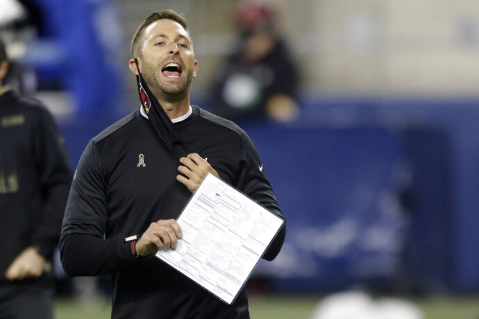 Arizona Cardinals head coach Kliff Kingsbury removes his mask to yell before an NFL football game against the Seattle Seahawks, Thursday, Nov. 19, 2020, in Seattle. (AP Photo/Lindsey Wasson)