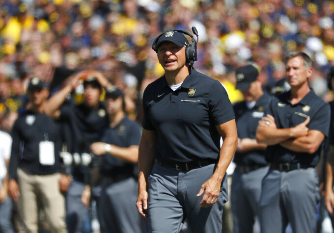 FILE - In this Sept. 7, 2019, file photo, Army coach Jeff Monken watches during the first half of the team's NCAA college football game against Michigan in Ann Arbor, Mich. Army faces VMI on Saturday, Monken says he never gets too emotional on Senior Day. This time might be different. In his six seasons at West Point, Monken has transformed the Black Knights from an afterthought into a team to be reckoned with, and this senior class of 30 has been an integral part of that transformation. (AP Photo/Paul Sancya, File)