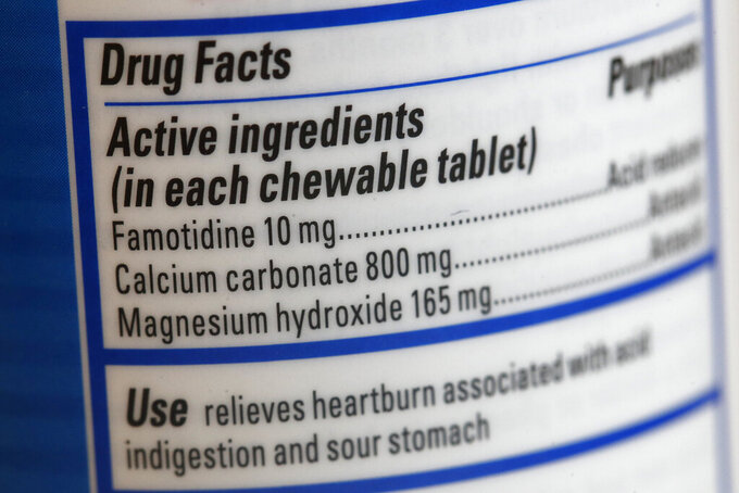 This June 15, 2020 photo shows a Pepcid antacid label listing the active ingredient famotidine in Washington. The U.S. government's Pepcid project has revealed what critics describe as the Trump administration's disregard for science and anti-corruption rules meant to guard against taxpayer dollars going to political cronies or funding projects that aren't rigorously designed. (AP Photo/Patrick Semansky)