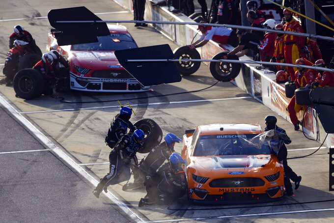 Chris Buescher pits stops during a NASCAR Cup Series auto race Sunday, Sept. 5, 2021, in Darlington, S.C. (AP Photo/John Amis)
