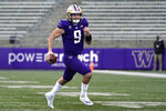 Washington quarterback Dylan Morris carries the ball against Stanford in the second half of an NCAA college football game Saturday, Dec. 5, 2020, in Seattle. (AP Photo/Elaine Thompson)
