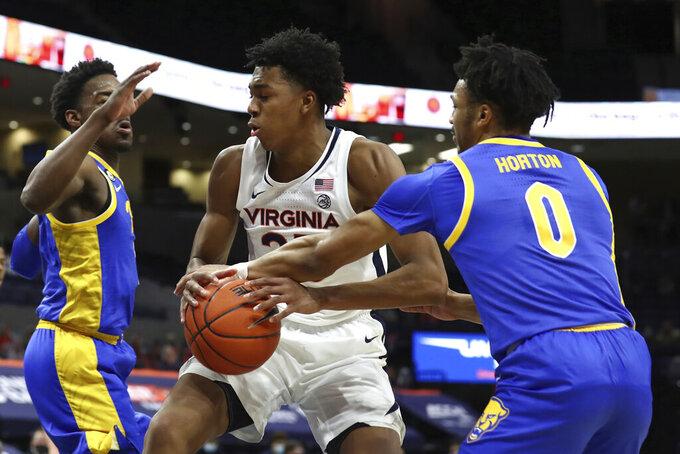 Virginia guard Trey Murphy III (25) is blocked by Pittsburgh guard Ithiel Horton (0) during an NCAA college basketball game Saturday, Feb. 6, 2021, in Charlottesville, Va. (Erin Edgerton/The Daily Progress via AP, Pool)