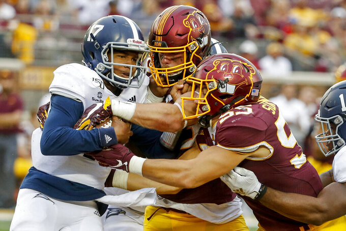 Minnesota linebackers Carter Coughlin (45) and Mariano Sori-Marin (55) stop Georgia Southern quarterback Justin Tomlin (17) and force a fumble in the fourth quarter of an NCAA college football game Saturday, Sept. 14, 2019, in Minneapolis. (AP Photo/Bruce Kluckhohn)