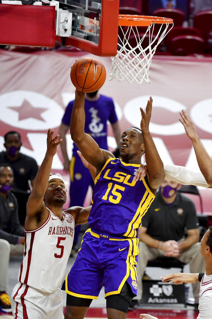 LSU guard Aundre Hyatt (15) drives past Arkansas guard Moses Moody (5) during the second half of an NCAA college basketball game in Fayetteville, Ark. Saturday, Feb. 27, 2021. (AP Photo/Michael Woods)